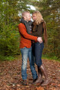 Young couple almost kissing happy is having a nice time in october Stock Image