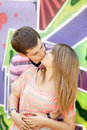 Young couple kissing near graffiti background. Royalty Free Stock Photography