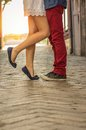 Young couple kissing outdor outdoor close up on feet Royalty Free Stock Images