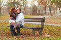 Young couple kissing in the park in autumn Stock Photos