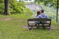 Young couple kissing in the park teenage at letchworth state new york Stock Image