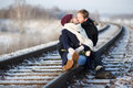 Young couple kissing on railway Stock Images