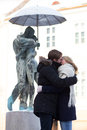 Young couple kissing at statue Stock Photos