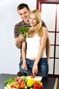 Young couple at the kitchen Stock Image