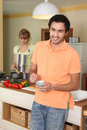 Young couple in a kitchen Royalty Free Stock Image