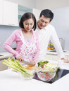 Young couple in kitchen asian preparing meal together Stock Photography