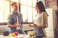 Young couple in kitchen Royalty Free Stock Photo