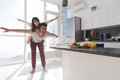 Young Couple In Kitchen, Lovers Hispanic Man Carry Asian Woman Modern Apartment Royalty Free Stock Photo