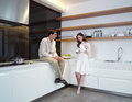 Young couple in the kitchen zx Royalty Free Stock Photo
