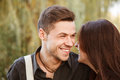 Young couple laughing walking in park close up Stock Photo