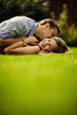 Young couple lie on the lawn Royalty Free Stock Photo