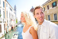 Young couple lifestyle walking in venice on travel together happy on holidays or honeymoon having cute romantic vacation Stock Photo