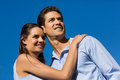Young couple looking away against blue sky loving and happy clear Stock Images