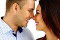 Young couple looking at each other happy over white background Royalty Free Stock Photos