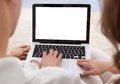 Young couple looking at a laptop together beautiful sitting side by side on sofa Royalty Free Stock Photos