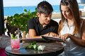 Young couple looking at menu in restaurant close up portrait of cute teen Royalty Free Stock Image