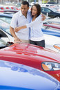 Young couple looking at new cars Stock Images