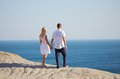 Young couple looking at the sea Royalty Free Stock Image