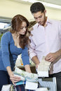 Young couple looking at textile samples in store Stock Image