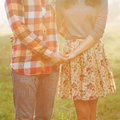 Young couple in love happy holding hands looking the sunset Royalty Free Stock Photo