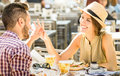Young couple in love having fun at beer bar on travel excursion Royalty Free Stock Photo