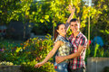 Young couple in love is having fun outdoors young beautifull ma men and women dressed casual country style are hugging a sunny Stock Photos