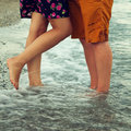 Young couple in love hugging and kissing on the beach two lovers man woman barefoot water summer Royalty Free Stock Images