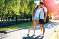 Young couple in love kissing walking in city park at summer Royalty Free Stock Photo