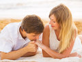 Young couple in love man and woman enjoying romantic afternoon women sunset at the beach Stock Photos