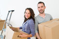 Young couple in love moved in their new flat view of a Stock Image