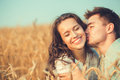 Young couple in love outdoor.Couple hugging.Young beautiful couple in love staying and kissing on the field on sunset. Royalty Free Stock Photo