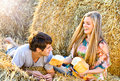 Young couple in love outdoor field with hay Stock Photo