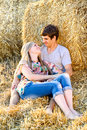 Young couple in love outdoor field with hay Stock Photos