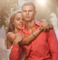 Young couple in love outdoor romantic enjoying sun sunshine romance and Royalty Free Stock Photo