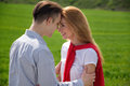 Young couple in love outdoor they are smiling and looking at looking at each other Stock Image