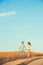 Young couple in love outdoor.Stunning sensual outdoor portrait of young stylish fashion couple posing in summer in field Royalty Free Stock Photo
