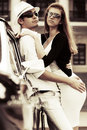 Young couple in love at the retro car fashionable on a city street Stock Photography
