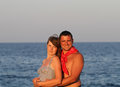 Young couple in love in the sea Stock Photos