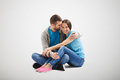 Young couple in love sitting on the floor Royalty Free Stock Photo