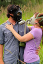 Young Couple in Love Wearing Gas Masks Stock Photos