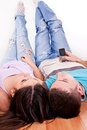 Young couple lying on the floor Royalty Free Stock Photo