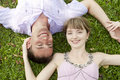 Young couple lying on grass Royalty Free Stock Photo
