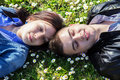 Young couple lying on grass portrait of spring day Royalty Free Stock Photography