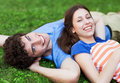 Young couple lying on grass smiling Stock Image