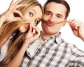 Young couple making fake moustache from hair people friendship love and leisure concept beautiful loving while standing isolated Royalty Free Stock Photo