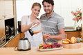 Young couple making fruits juice Stock Images