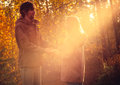 Young couple man and woman hugging in love romantic outdoor with sun light autumn nature on background fashion trendy style Stock Photography