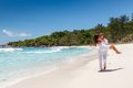 Young couple married laying on sandy beach Stock Photos