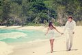 Young couple married laying on sandy beach beautiful tropical seychelles la digue Royalty Free Stock Photography