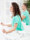 Young  couple meditating together in their bedroom Royalty Free Stock Photo